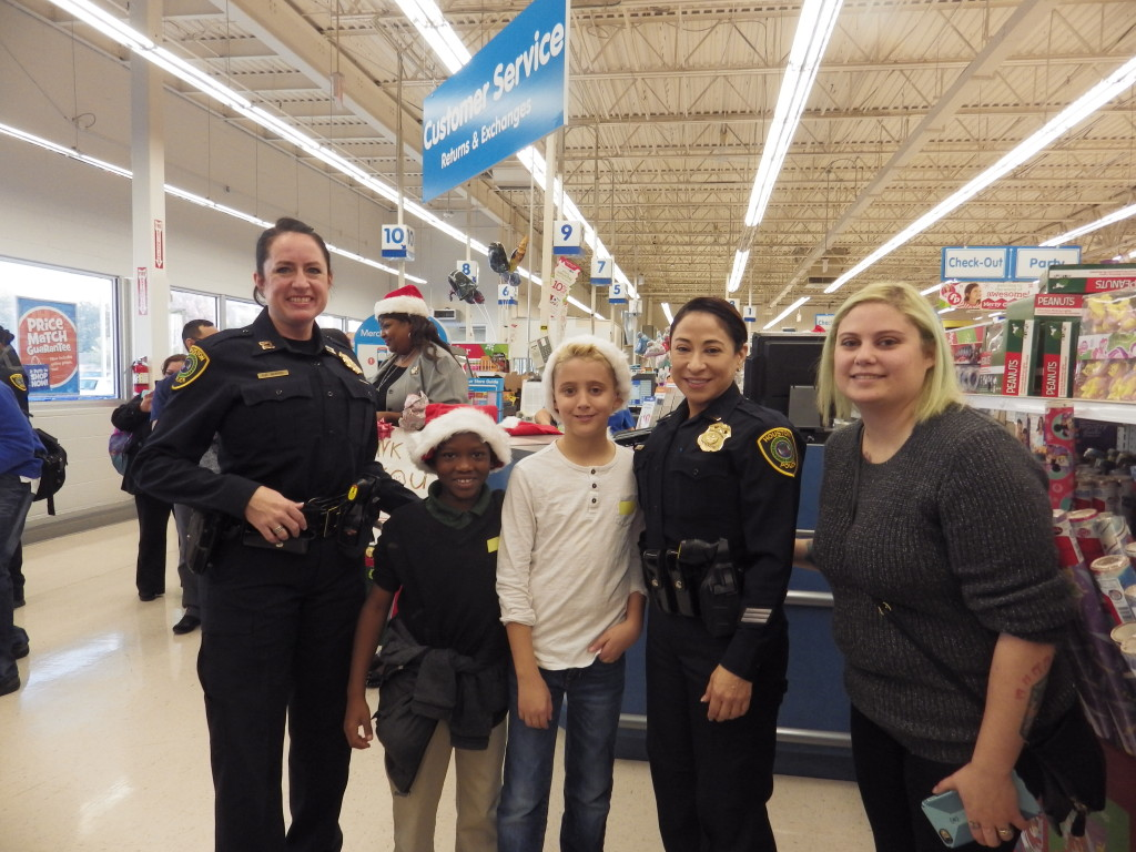 Captain Heather Morris and Officer Patricia Cantu with thier shopping partners