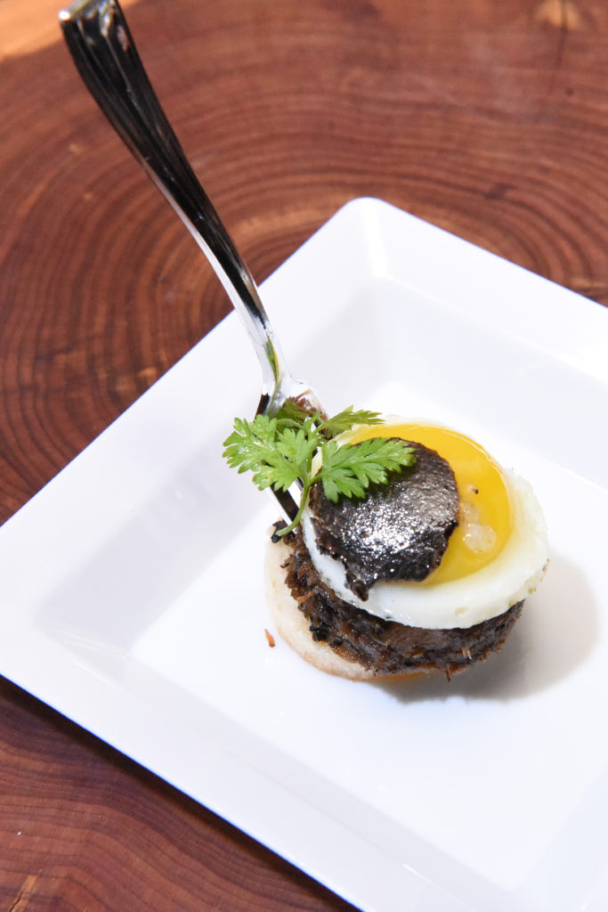 Le Mistral's  Braised Beef Oxtail, Fried Quail Egg Truffle Stacker